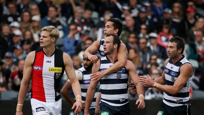 Matthew Stokes jumps on the back of Josh Walker after he kicked a goal on the quarter-time siren. Picture: Colleen Petch