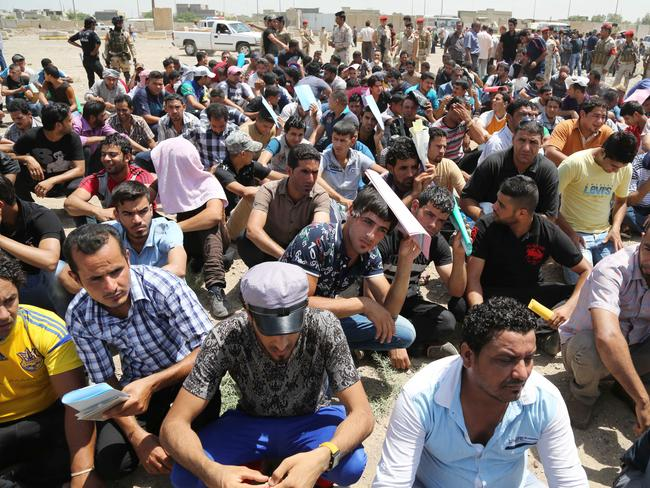 Volunteers ... hundreds of young Iraqi men have streamed into centres across Baghdad to join the fight against Sunni militants advancing in the north. Picture: Karim Kadim