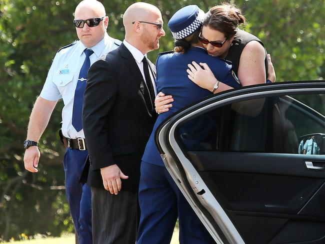 The widow is consoled by a female police officer. Picture: Troy Snook