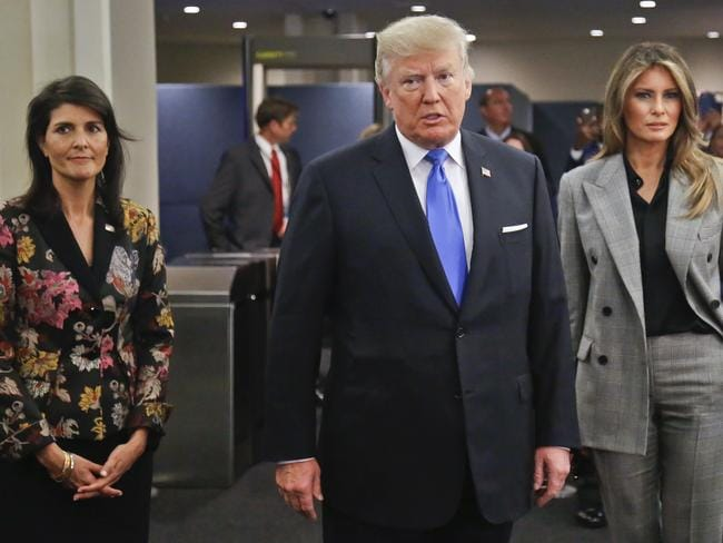 US President Donald Trump, centre, arrives with first lady Melania Trump, right, and US United Nations Ambassador Nikki Haley, left. Picture: AP