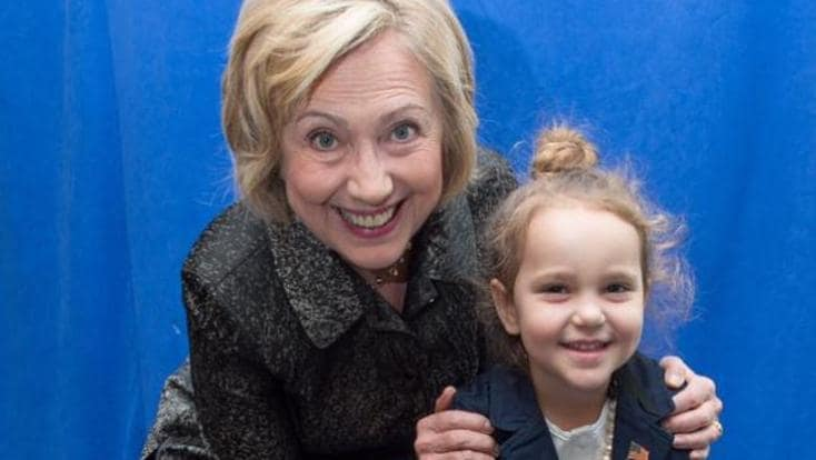 Hillary Clinton poses with four-year-old Sullivan at an event in Charleston. Sullivan has dressed up like Clinton for Halloween. Picture: Facebook.