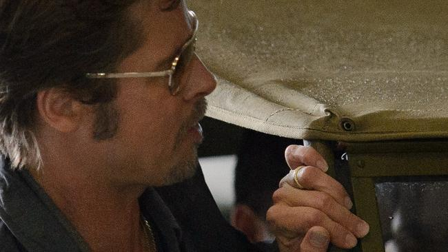 Hitched ... Brad Pitt wearing his wedding ring in Dorset, southern England, on Thursday. Picture: AFP