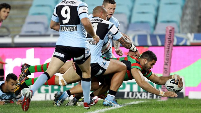 Greg Inglis dives over to score during the South Sydney Rabbitohs and Cronulla Sharks NRL game at ANZ Stadium.