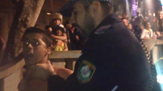 Jamie Jackson arrested by a police officer on Mardi Gras night