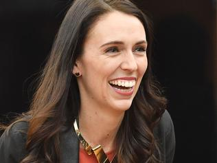 New Zealand's Labour party leader Jacinda Ardern receives applause as she is welcomed to her first caucus meeting as Prime Minister-elect at Parliament in Wellington on October 20, 2017. New Zealand's Prime Minister-elect Jacinda Ardern expressed confidence October 20 that her new government would see out its full term, despite long-standing tensions between her coalition partners. / AFP PHOTO / Marty MELVILLE