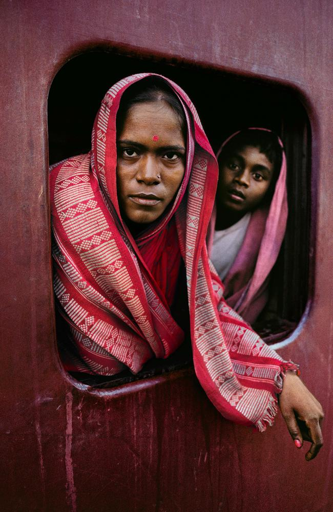 Steve McCurry: India exhibtion - Woman and child on the Howrah Mail train en-route to Kolkata, West Bengal Steve McCurry,1982. Picture: Steve McCurry