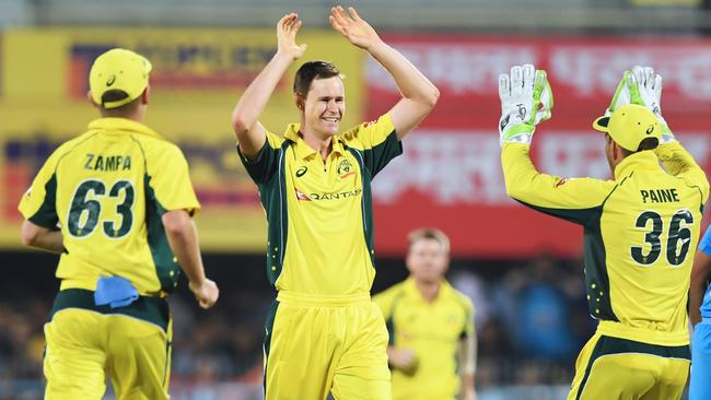 Australia's Jason Behrendorff (2L) celebrates after taking the wicket of India's Rohit Sharma.