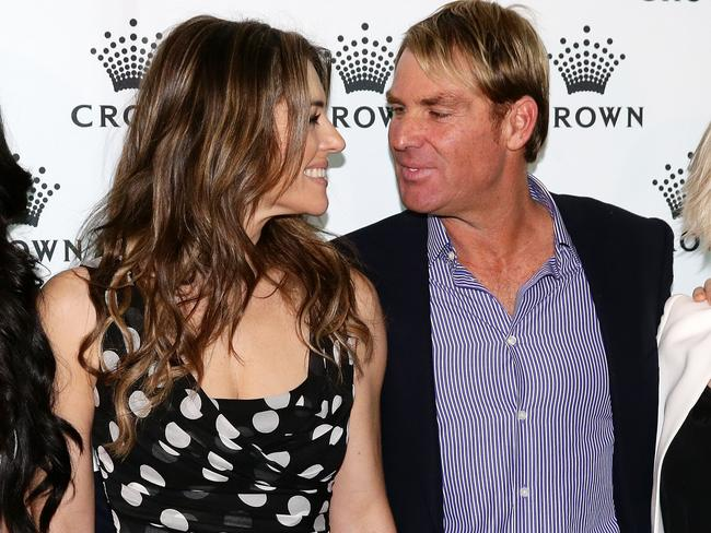 Happier times ... Shane Warne with English actor and model Elizabeth Hurley. Picture: Tauber Andrew