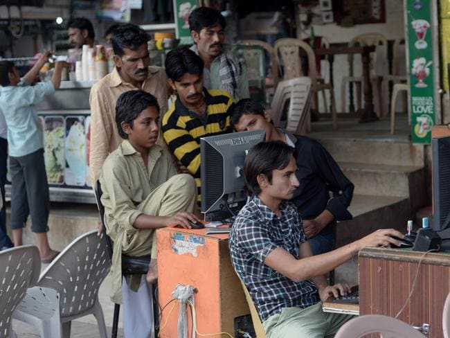 Sensitivities ... computer users at a market in Faisalabad, Pakistan on May 9, 2014. Picture: Farooq Naeem