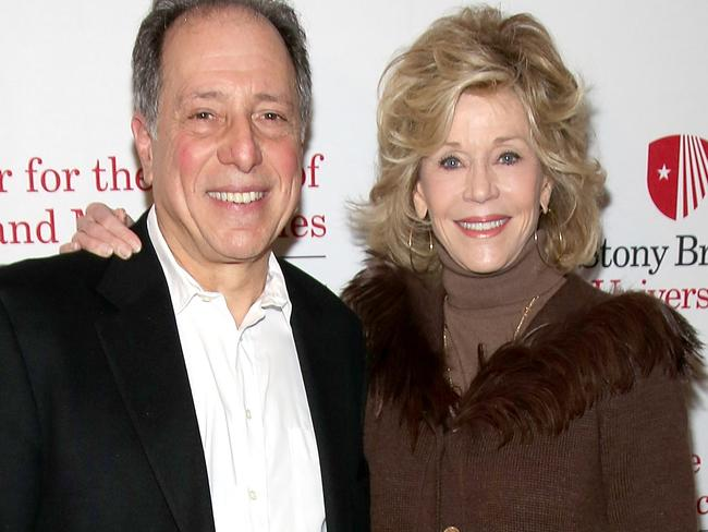 Michael Kimmel, pictured with Jane Fonda, says we need to ask what it means to be a man. Picture: Paul Zimmerman