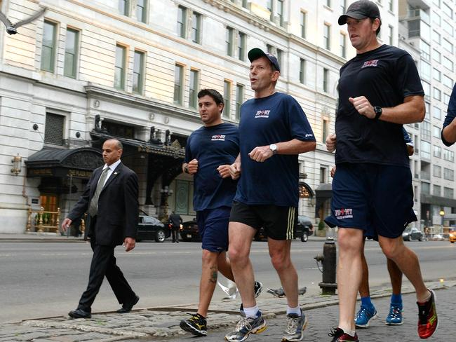 Running man ... Abbott takes an early morning jog through Central Park with members of the NY fire department. Picture: Jake Nowakowski