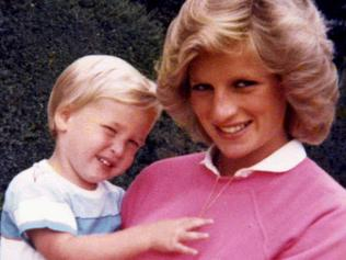 """Embargoed until July 22, 2017 - 23:01 GMT / An undated handout picture released by Kensington Palace from the personal photo album of the late Diana, Princess of Wales shows her holding Prince William while pregnant with Prince Harry at an undisclosed location. Britain's Prince William and Prince Harry have revealed they talked to their mother, Lady Diana, on the day she died and that the """"short"""" conversation now weighs """"heavily"""" on their mind. / AFP PHOTO / KENSINGTON PALACE / The Duke of Cambridge and Prince / RESTRICTED TO EDITORIAL USE - NO USE ON THE FRONT COVER OF ANY UK OR INTERNATIONAL MAGAZINES - MANDATORY CREDIT """"AFP PHOTO / DUKE OF CAMBRIDGE AND PRINCE HARRY / KENSINGTON PALACE"""" - NO MARKETING NO ADVERTISING CAMPAIGNS - DISTRIBUTED AS A SERVICE TO CLIENTS - NO ARCHIVES - NO SALES - NO USE AFTER JULY 31, 2017 /"""