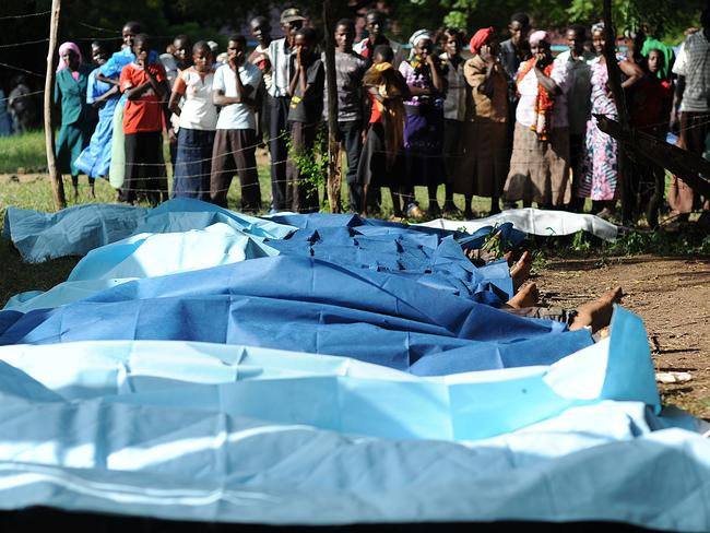 Body bags ... family members wait to collect bodies of their relatives at Mpeketoni hospital.