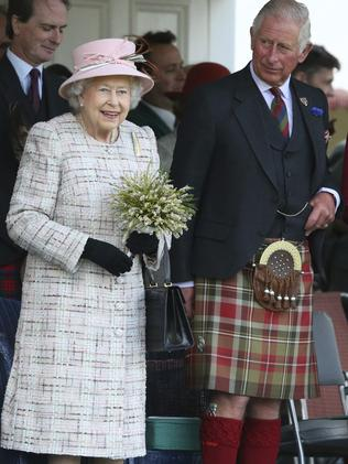 Queen Elizabeth II and Prince Charles in Scotland. Picture: AP