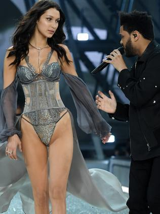 Bella Hadid walks the runway as The Weeknd performs. Picture: Getty
