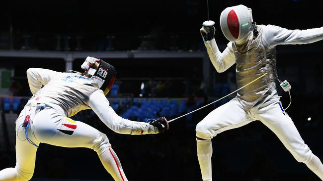 Fencer's phone falls out of pocket during Olympics match