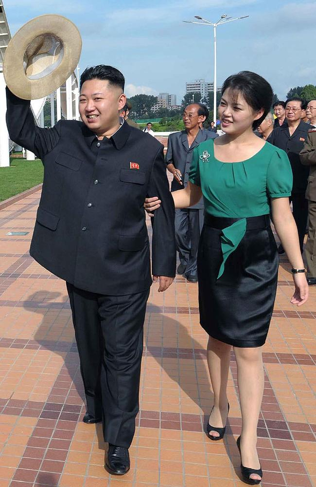 Kim Jong-un and his wife Ri Sol-Ju visit a wading pool at the Rungna People's Pleasure Ground in Pyongyang in 2012. Picture: AFP / KCNA via KNS