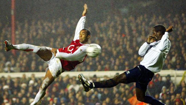 DECEMBER 21, 2002: Ehiogu defends Arsenal's French striker Thierry Henry (L)