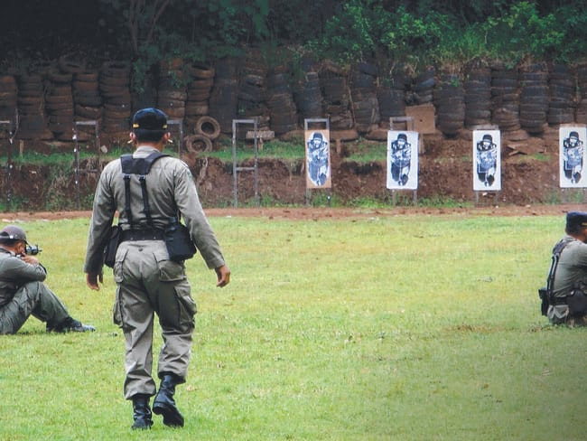 Some of Brimob ... Indonesian Paramilitary Police practise shooting target. Picture: Supplied.