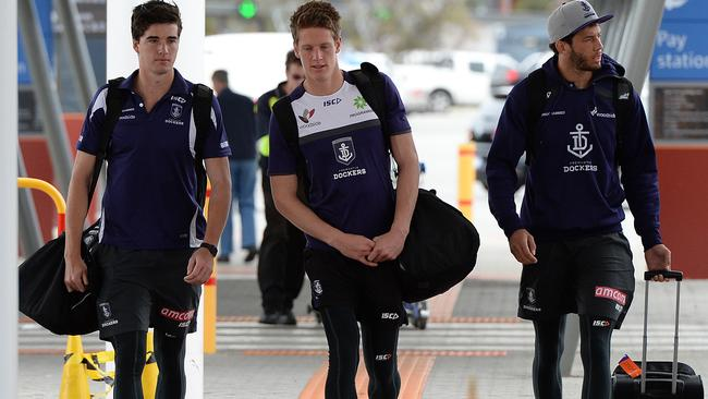 Alex Pearce (left) with Matt Taberner and Zac Clarke at Perth Airport. Picture: Daniel Wilkins