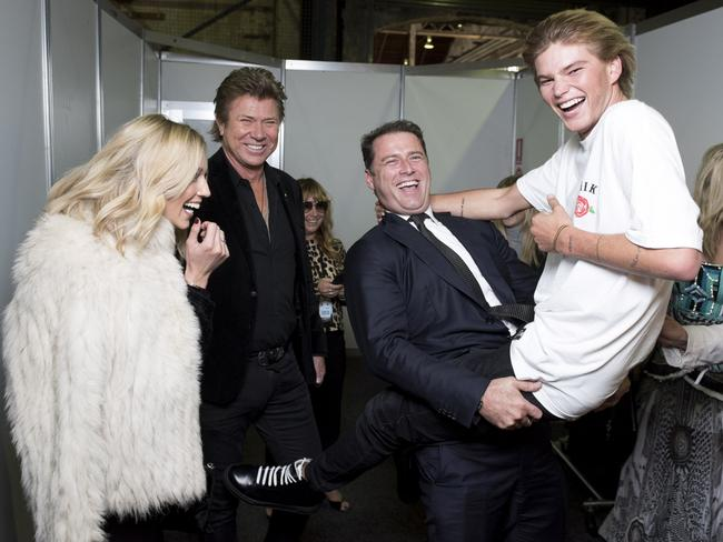 Karl Stefanovic and his girlfriend Jasmine Yarbrough, with Richard Wilkins and model Jordan Barrett backstage at Fashion Week. Picture: Sweaty Betty