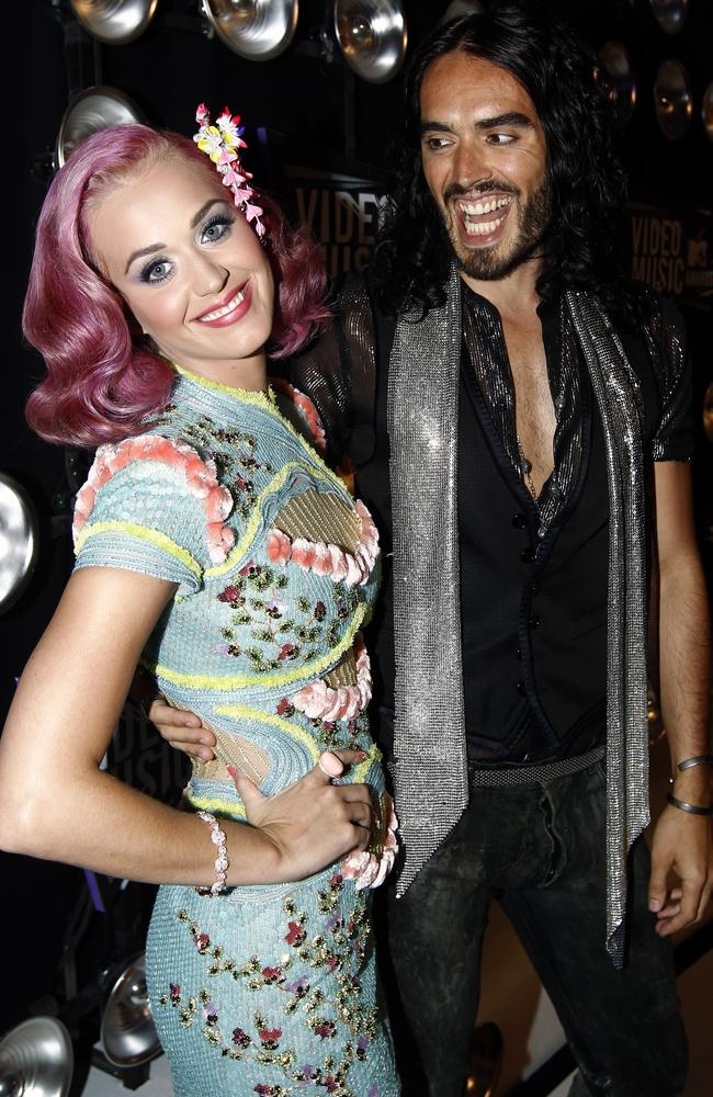 Russell Brand, right, ended his 14-month marriage to Katy Perry via text in December 2011. Picture: AP