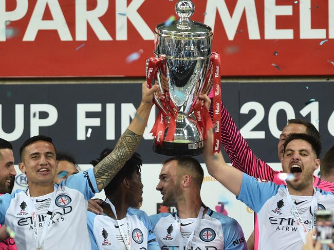 Melbourne City players Tim Cahill (left) and Bruno Fornaroli hold the FFA Cup.