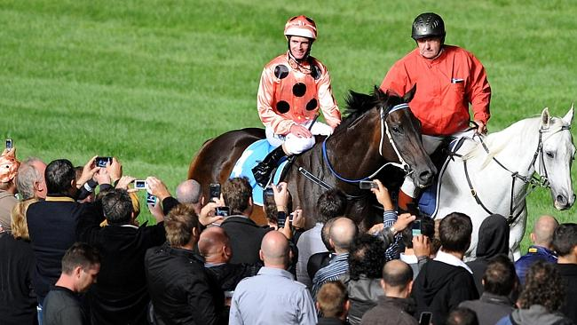 Luke Nolen returns to scale aboard Black Caviar after the William Reid Stakes as the great mare makes it 11 wins from 11 starts.