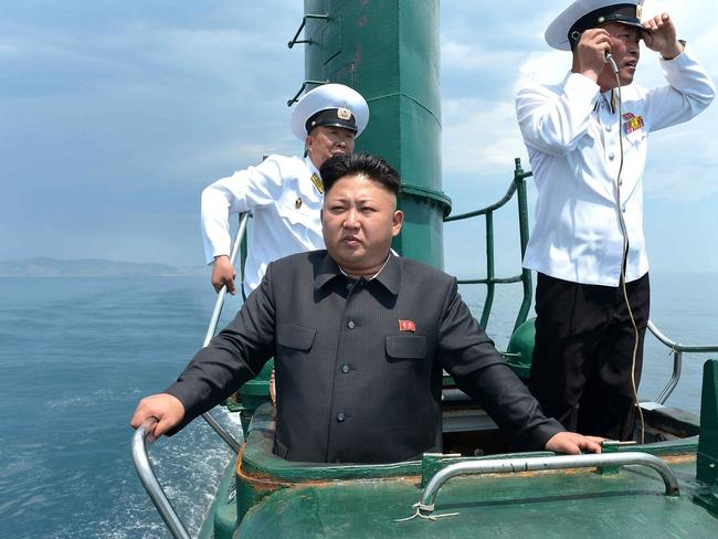 Miliary arsenal...An undated picture released by North Korea's official Korean Central News Agency shows North Korean leader Kim Jong-un inspecting a submarine. Picture:AFP / KCNA via KNS