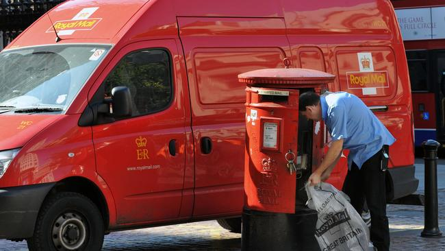 Britain's Royal Mail delivers three times the items of Australia Post yet had only slightly more complaints. Picture: AP Photo/Ian Nicholson/PA.