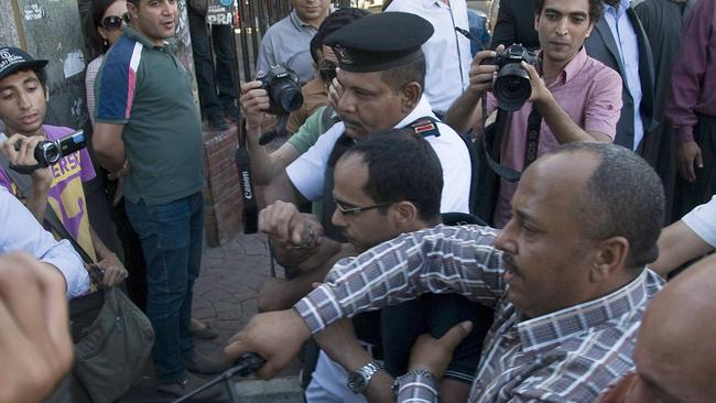 Crackdown ... Egyptian police arrest a man who allegedly harassed a woman during a protest by women against sexual harassment in Cairo.
