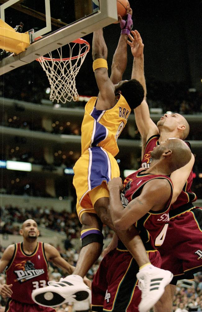 Kobe Bryant drives in for a dunk in 1999.