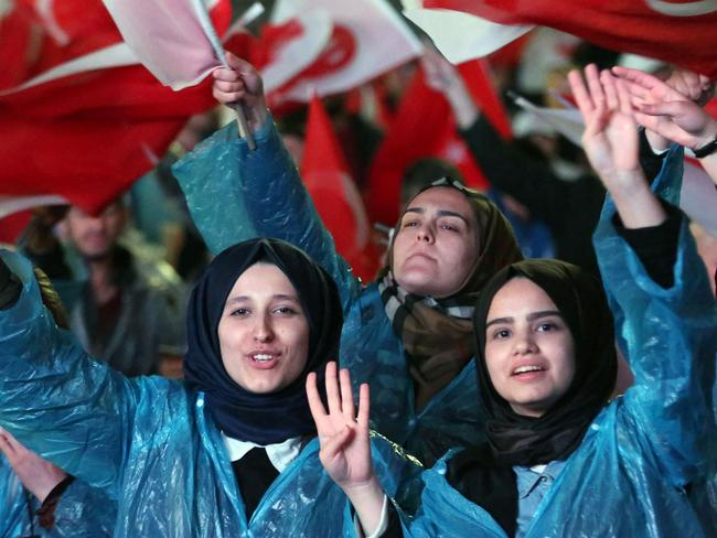 """Supporters of Turkey's president flash a four fingers sign called """"the rabia sign"""". Picture: Adem AltanAFP"""