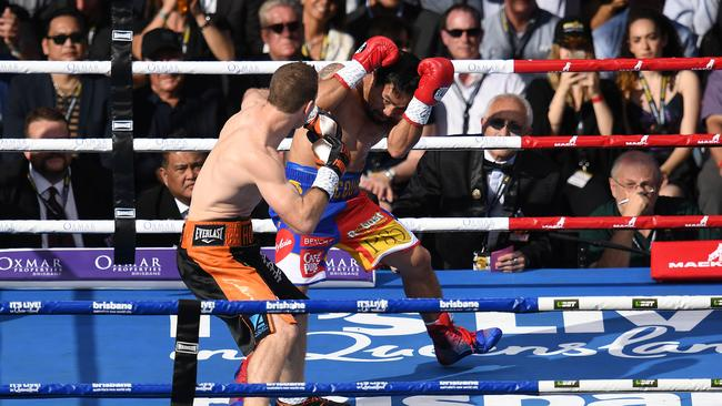 Manny Pacquiao covers up as Jeff Horn goes on the attack.