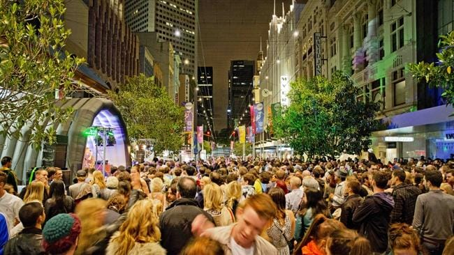 Revellers dance up a storm in Bourke Street Mall. Picture: Nathan Dyer