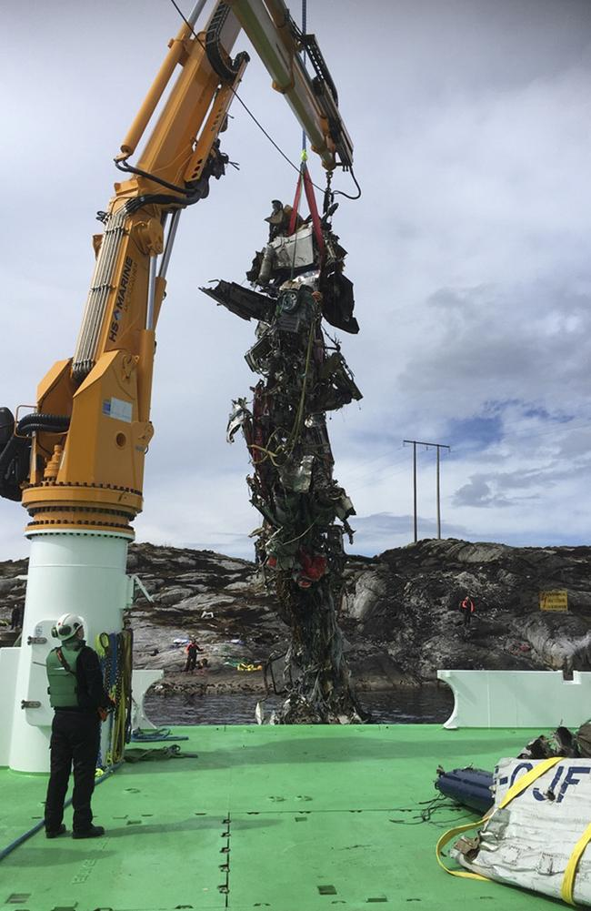 The remains of the helicopter are lifted from the North Sea onto a vessel. Picture: AFP / Accident Investigation Board AND NTB Scanpix