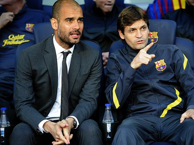 Former Barcelona coach Pep Guardiola (left) and then-assistant coach Tito Vilanova on the sideline in 2012.