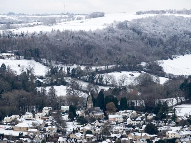 Snow covers the roofs of houses in Gloucestershire. Temperatures continue to plummet across the UK. Picture: Matt Cardy/Getty Images