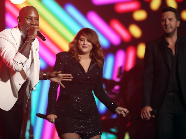 Tyrese, from left, Meghan Trainor, and Luke Bryan perform a tribute to MusiCares Person of the Year honoree Lionel Richie at the 58th annual Grammy Awards. Picture: AP