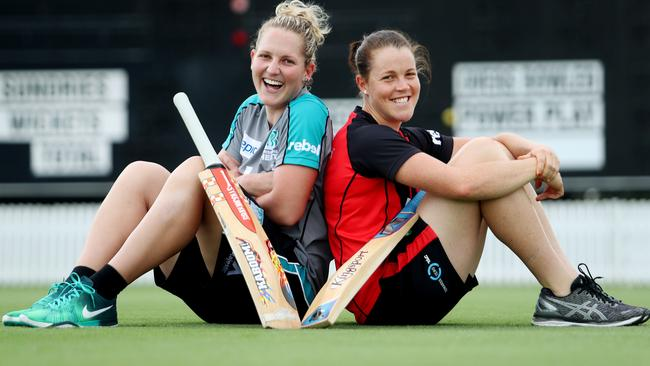 Laura and Grace Harris share a laugh before battle commences in the WBBL.