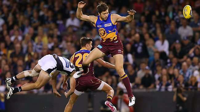 Stefan Martin (right) of the Brisbane Lions contests for the ball against Simon White.