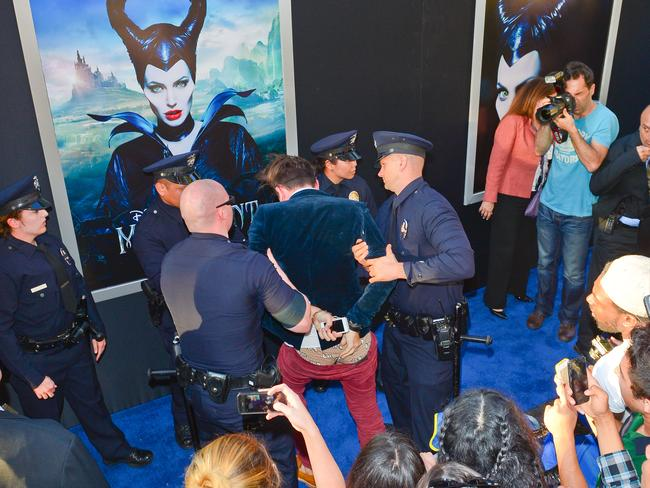 Vitalii Sediuk gets quickly taken down by security at the Maleficent premiere.