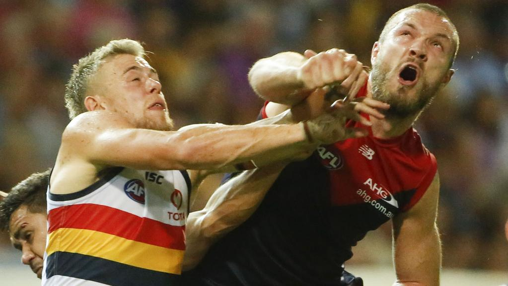 Melbourne ruckman Max Gawn, right, punches clear of Adelaide's Hugh Greenwood in the round 17 AFL clash at Darwin's TIO Stadium. Picture: GLEN CAMPBELL