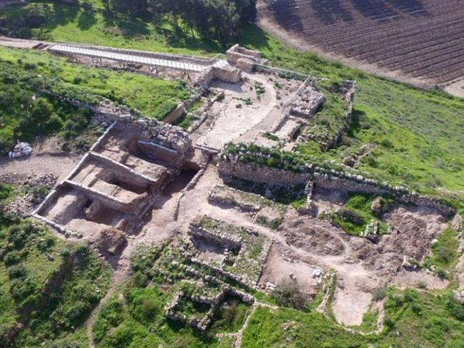 Archaeologists unearth ancient gate-shrine