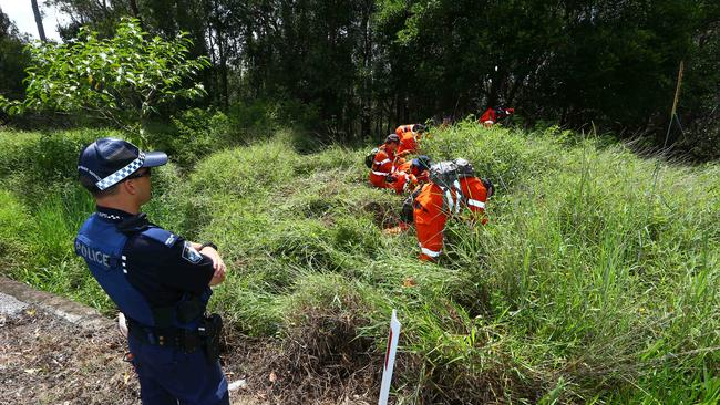 Police and SES combed a Gold Coast creek and roadside in December to search for an alleged murder weapon. Picture: David Clark