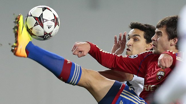 Moscow's Georgi Milanov, right, and Manchester City's Jesus Navas battle for the ball during the UEFA Champions League group D soccer match between CSKA Moscow and Manchester City.