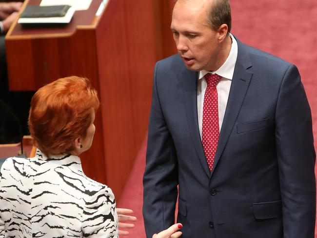 Senator Pauline Hanson talking to Immigration Minister Peter Dutton. Picture: Kym Smith