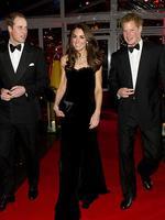 <p>Duchess of Cambridge in a strapless, velvet floor-length black gown alongside princes William and Harry. Photo: Arthur Edwards, AFP</p>