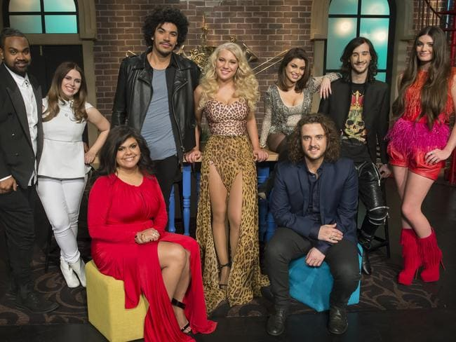 Anja Nissen, centre, looking like a bomshell in a tiger print outfit, with The Voice top eight.