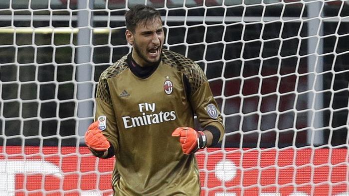 AC Milan goalkeeper Gianluigi Donnarumma celebrates after saving a penalty during the Serie A soccer match between AC Milan and Torino at the San Siro stadium in Milan, Italy, Sunday, Aug. 21, 2016. Bacca scored an hat-trick. (AP Photo/Antonio Calanni)